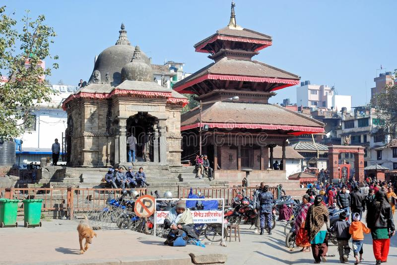 Temples of Kathmandu Durbar Square - Nepal. Activity with people at Kathmandu Durbar Square or Hanumandhoka Durbar Square with Hindu and Buddhist temples royalty free stock images