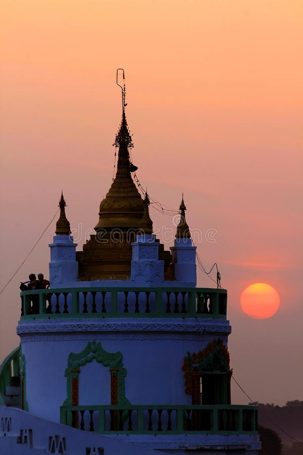 The temple has white and sunset in Myanmar. royalty free stock photography