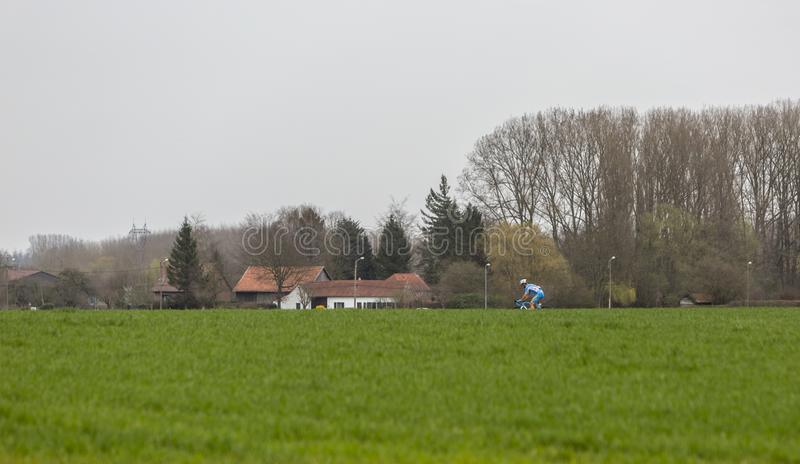 The Lonely Cyclist - Paris-Roubaix 2018 royalty free stock photography