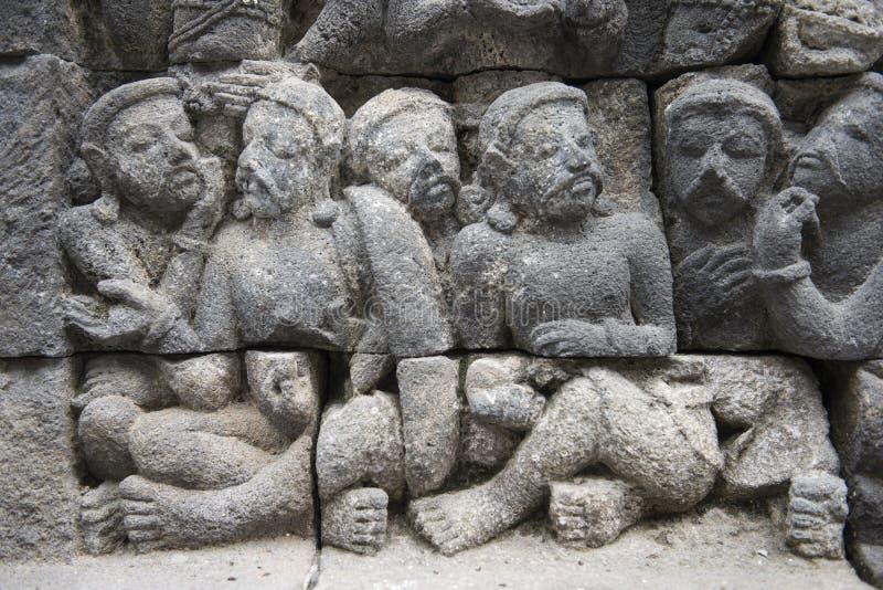 Templo budista de Borobudur, relevos de pedra, Java imagens de stock royalty free