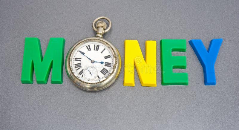 Tempo é dinheiro. foto de stock