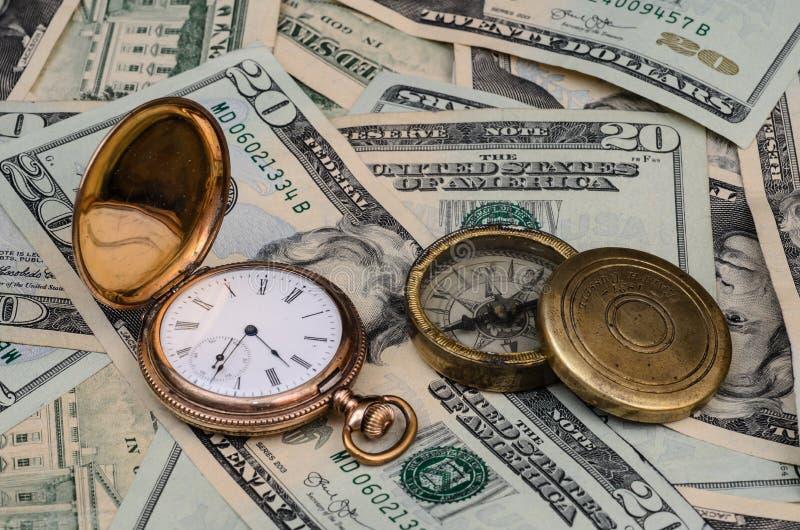 Tempo é dinheiro relógio e compasso foto de stock royalty free