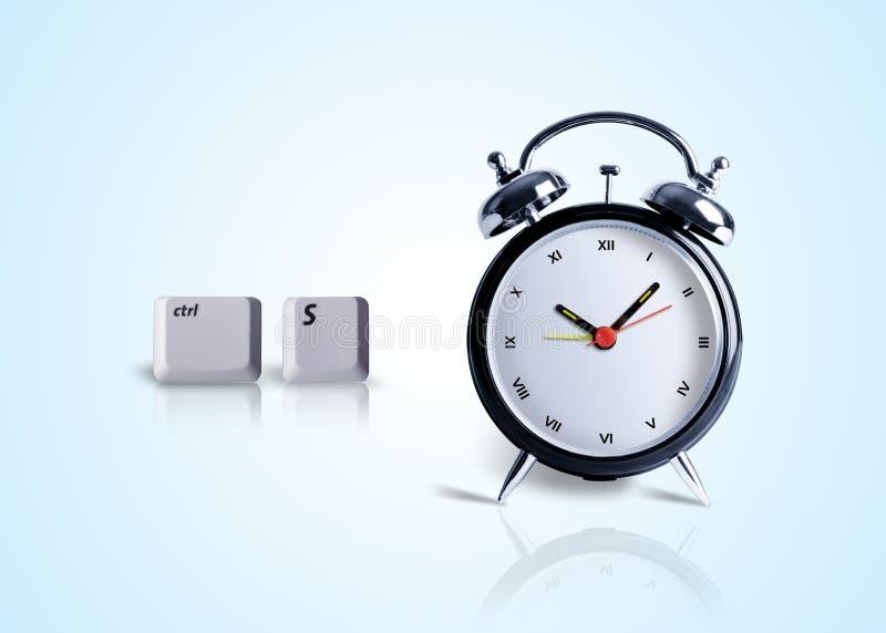 Tempo di risparmio, tasto di control+s con l'orologio fotografia stock libera da diritti