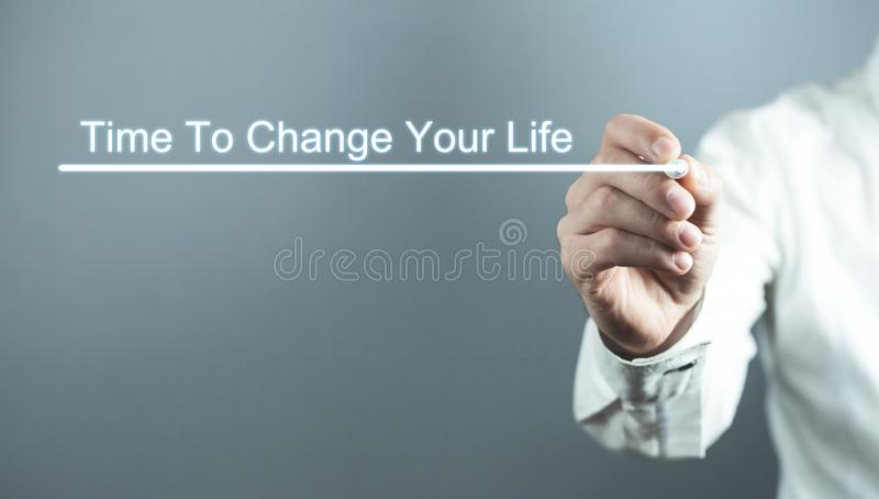 Tempo di scrittura della mano di cambiare la vostra vita Affare, concetto di motivazione fotografia stock libera da diritti