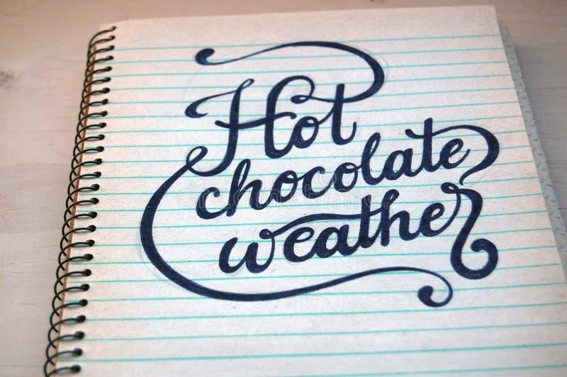 Tempo do chocolate do backgroundHot das uvas, no caderno espiral velho ilustração royalty free