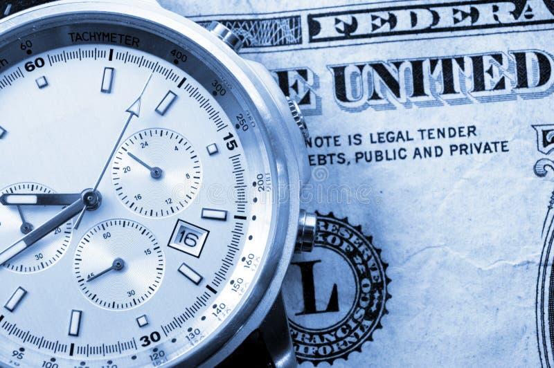 Tempo e soldi fotografia stock