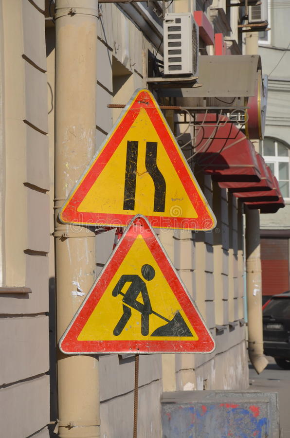 Temporary road signs. `Narrowing the road` and `Road works stock photography