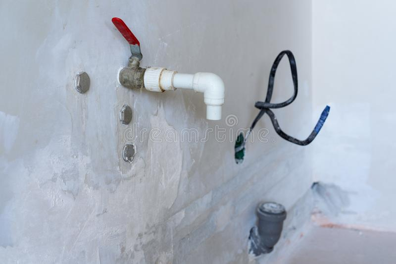 Temporary white plastic tap during the repair and installation of sewage pipes in the apartment stock image