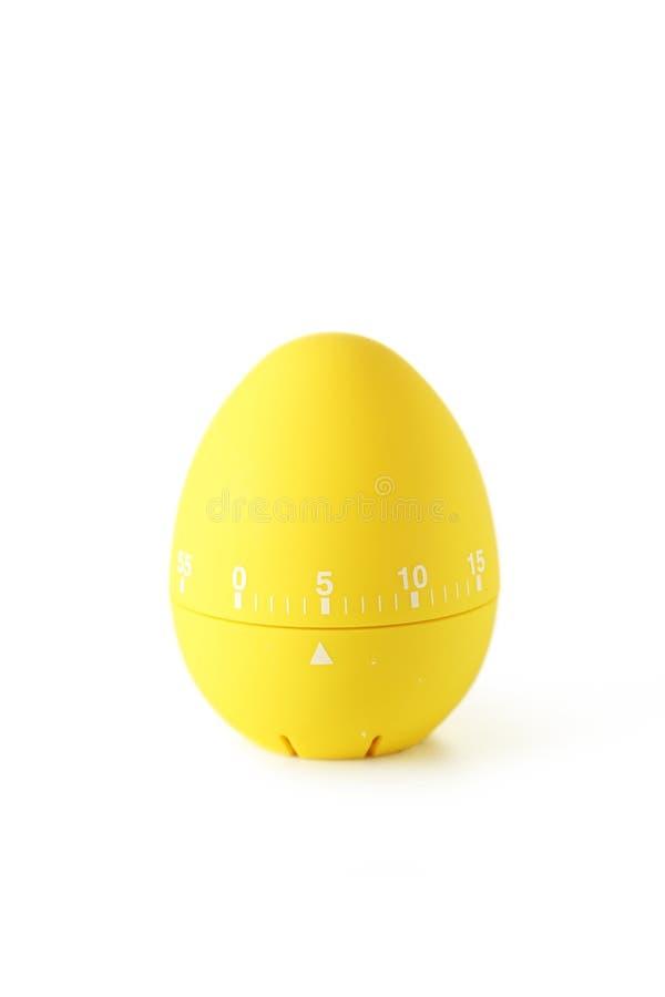 Temporizzatore giallo dell'uovo isolato su bianco fotografia stock