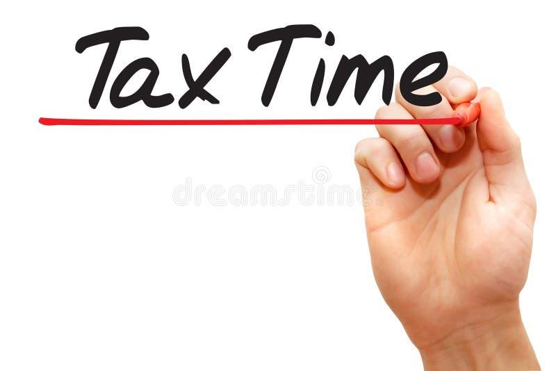 Temps d'impôts d'écriture de main, concept d'affaires image stock