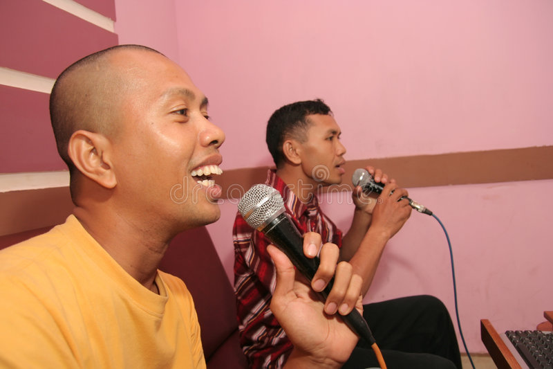 Temps de karaoke images libres de droits