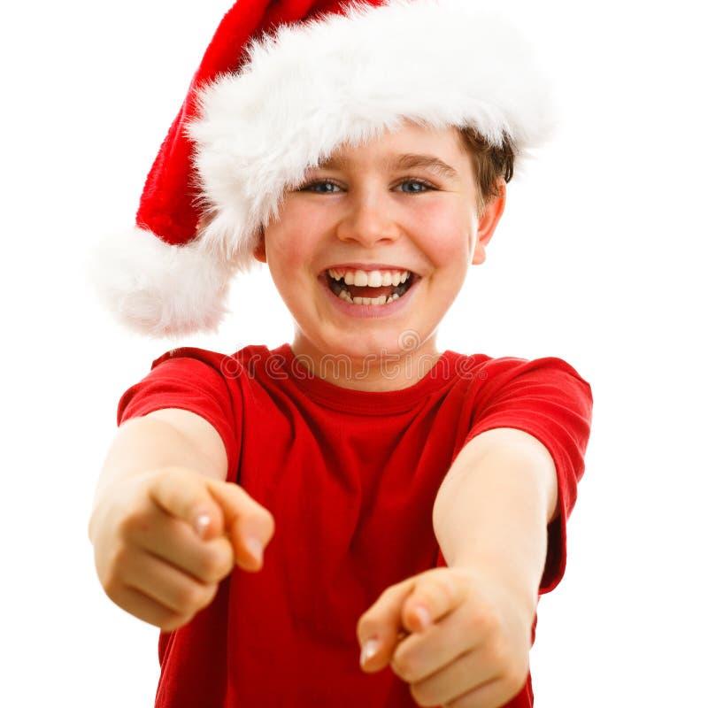 Temps de Noël - garçon avec Santa Claus Hat photographie stock libre de droits