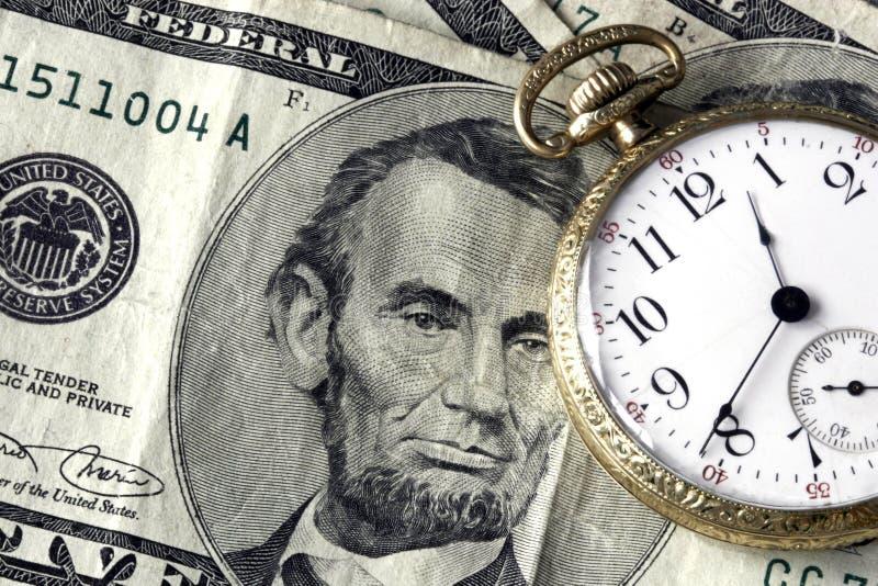 Temps et argent photographie stock libre de droits