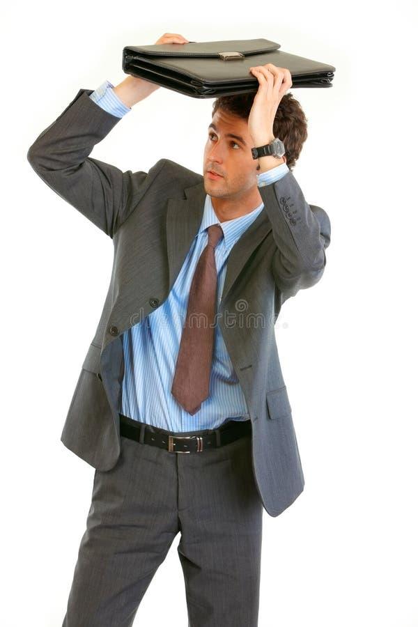 Temps système effrayé de serviette de fixation d'homme d'affaires photos stock