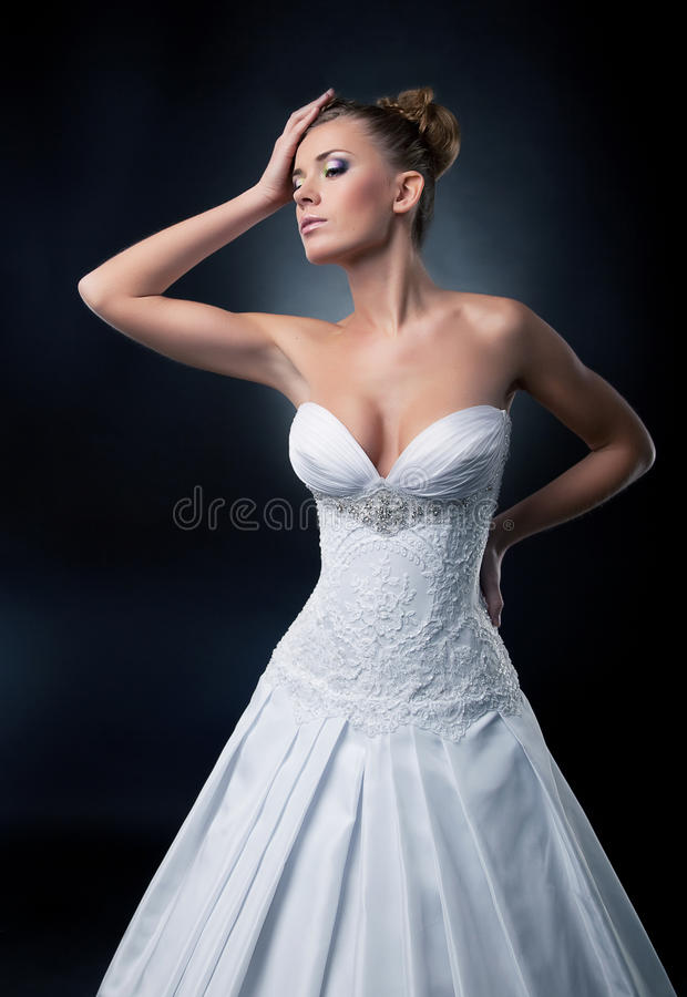 Tempting bride blonde fashion model posing stock images