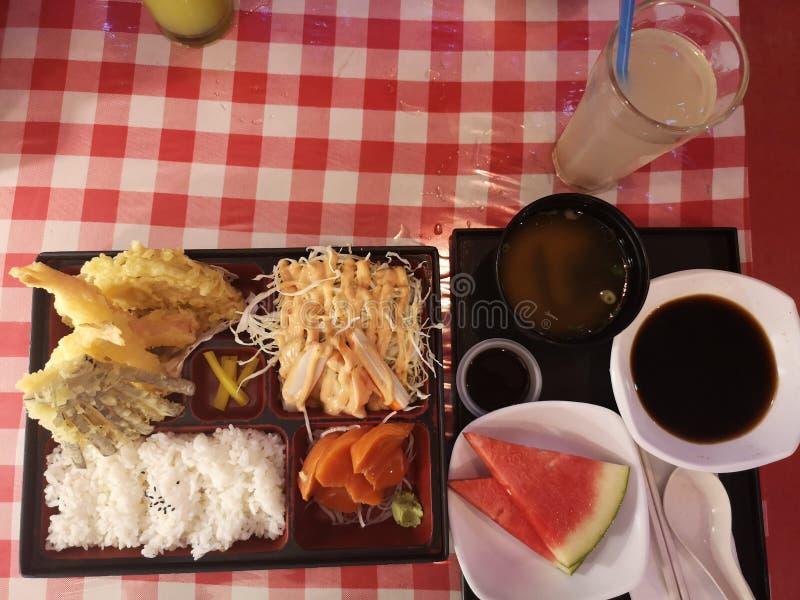 Tempura bento box with white rice and salmon sashimi royalty free stock photos