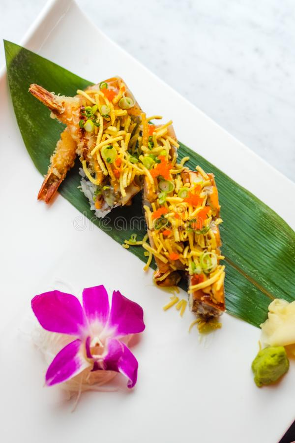 Tempura Fried Shrimp Sushi With Orchid Flower royalty free stock image