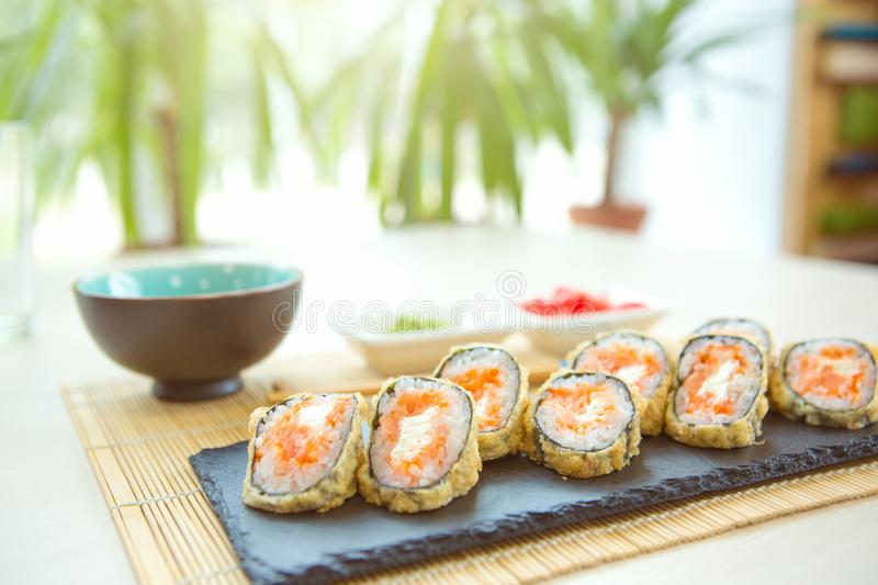 Tempura Roll with Crab and Lobster. Fried hot Roll with salmon, avocado, cucumber stock photos