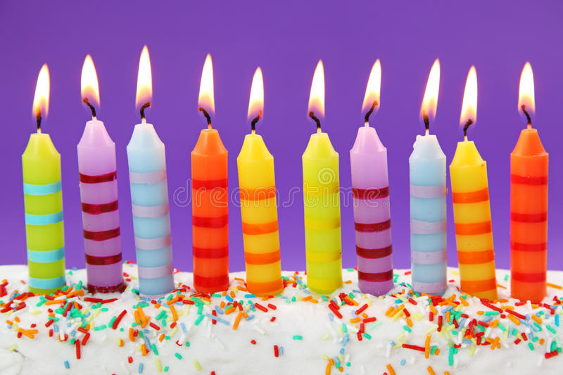 Ten birthday candles. On lilac background royalty free stock images