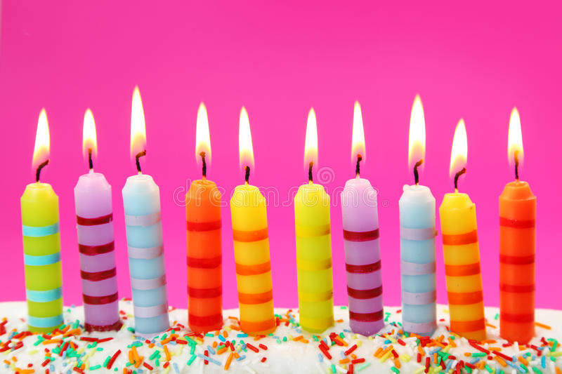Ten birthday candles. On pink background royalty free stock image