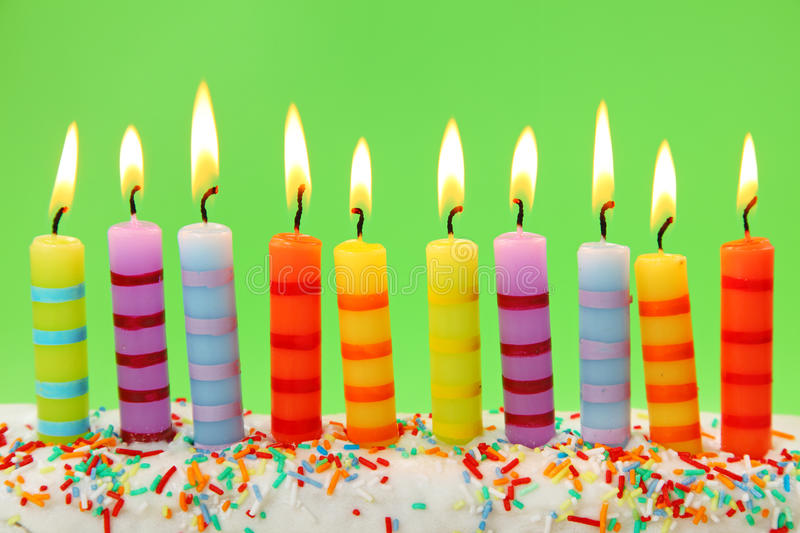 Ten birthday candles. On green background royalty free stock image
