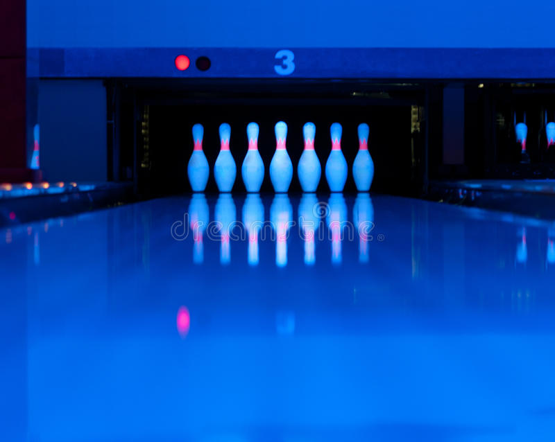 Ten bowling pins at the end of alley royalty free stock image