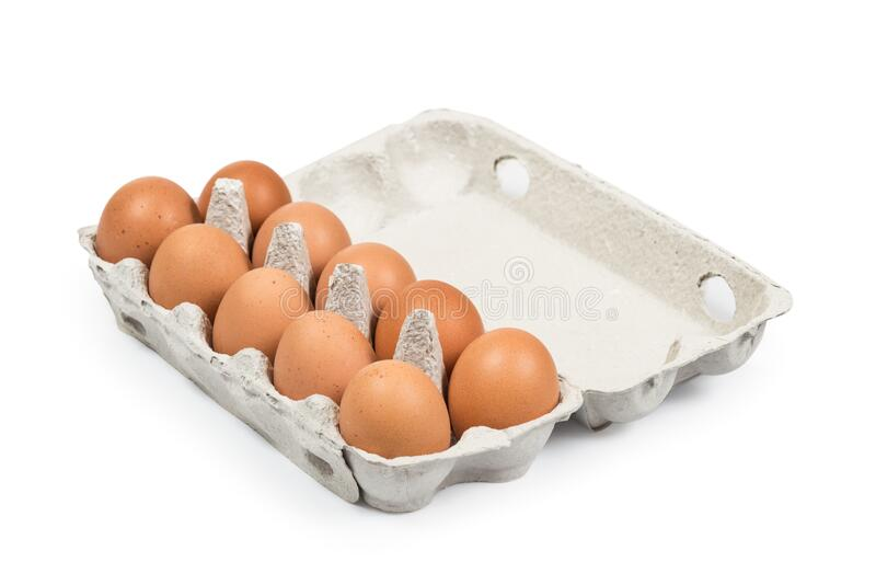 Ten Brown eggs in the cardboard package box high angle view isolated stock photography