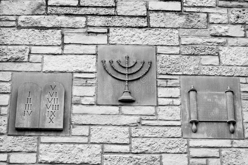 Ten Commandments, Menorah, Scroll - Religious Symbols. Three religious symbols representing the Ten Commandments, a Jewish Menorah and a Scroll on the side of royalty free stock photo