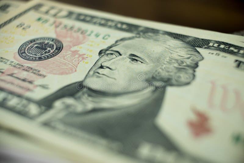 Ten dollars bill fragment of U.S. money in macro. Ten dollars bill fragment of U.S. money. Macro photo royalty free stock images