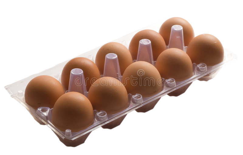 Ten eggs. On a tray on a white background royalty free stock photography