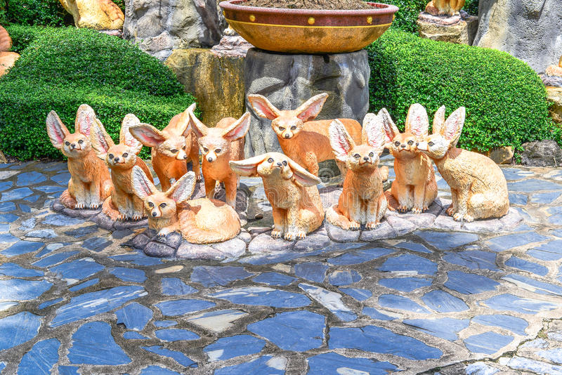 Ten foxes statue like cartoon royalty free stock photography