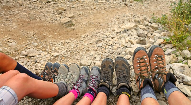 Ten hiking boots of a family of five persons. In mountain stock photo