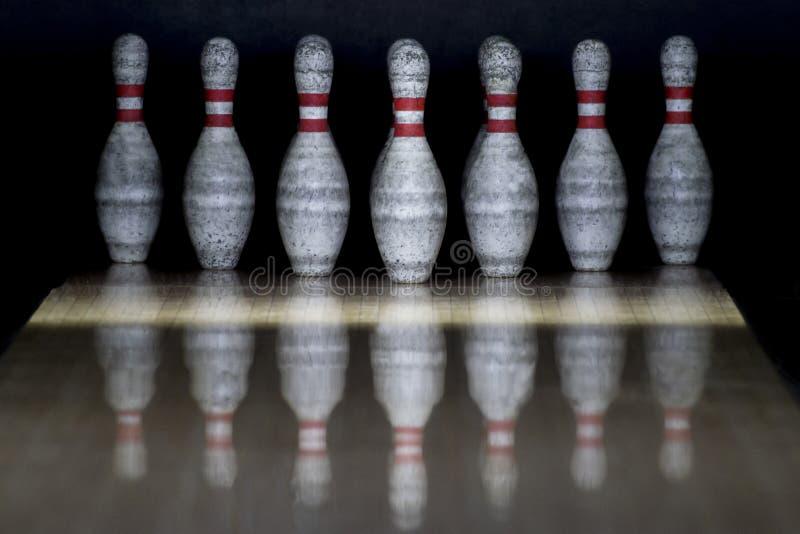 Ten pin bowling alley background. Closeup of tenpin row on a lan. E, night light royalty free stock photo