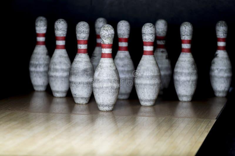 Ten pin bowling alley background. Closeup of tenpin row on a lan. E, night light royalty free stock photography