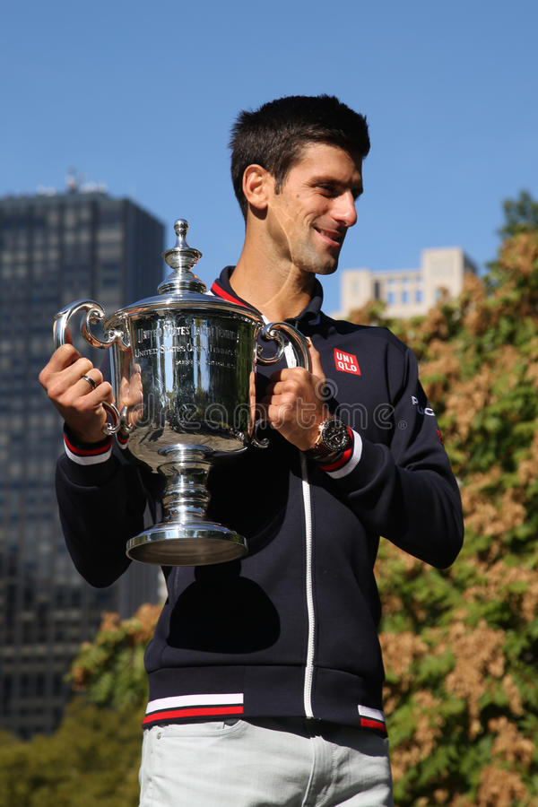Ten times Grand Slam champion Novak Djokovic posing in Central Park with championship trophy. NEW YORK - SEPTEMBER 14, 2015: Ten times Grand Slam champion Novak stock images