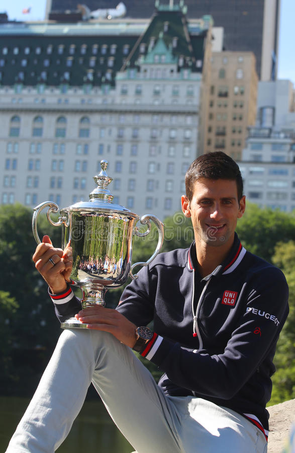 Ten times Grand Slam champion Novak Djokovic posing in Central Park with championship trophy. NEW YORK - SEPTEMBER 14, 2015: Ten times Grand Slam champion Novak royalty free stock photo