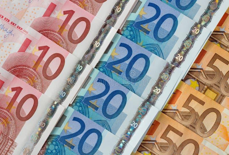 Ten, twenty and fifty euro notes diagonal rows. royalty free stock photography