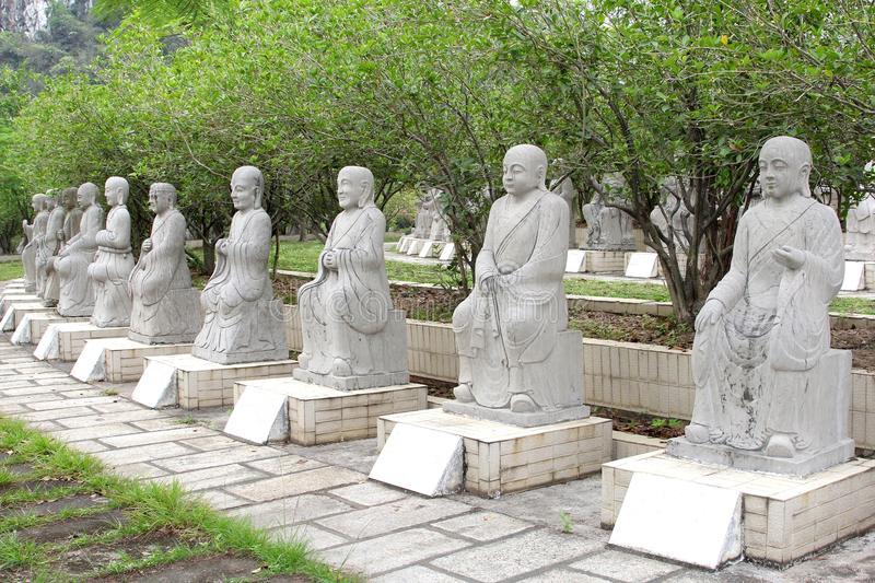 Ten white marble Buddha statues in a national park, China royalty free stock photo