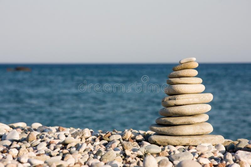 Ten white pebbles on beach royalty free stock photos