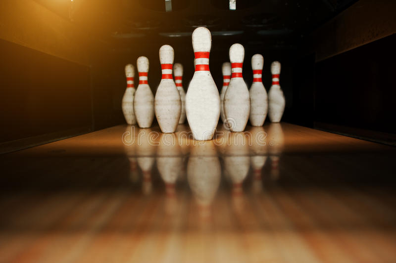 Ten white pins in a bowling alley lane royalty free stock photography