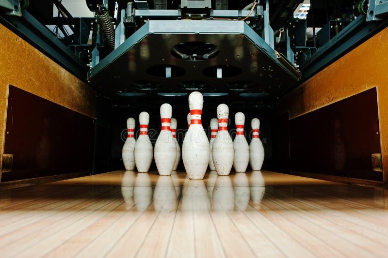 Ten white pins in a bowling alley lane.  stock photos