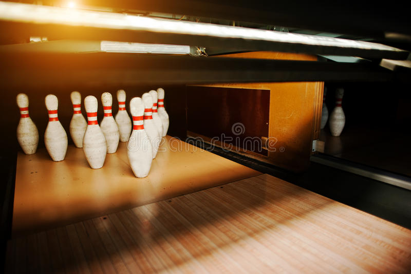 Ten white pins in a bowling alley lane.  royalty free stock photo