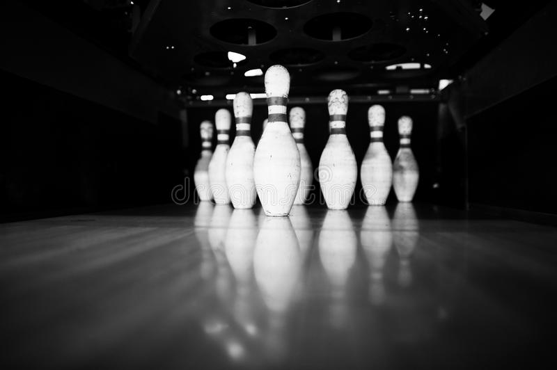 Ten white pins in a bowling alley lane.  royalty free stock image