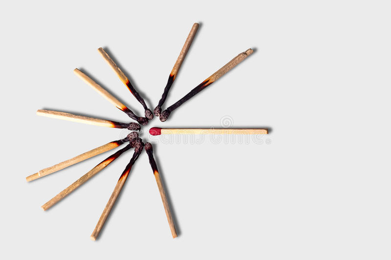 Ten wooden matches in a circle