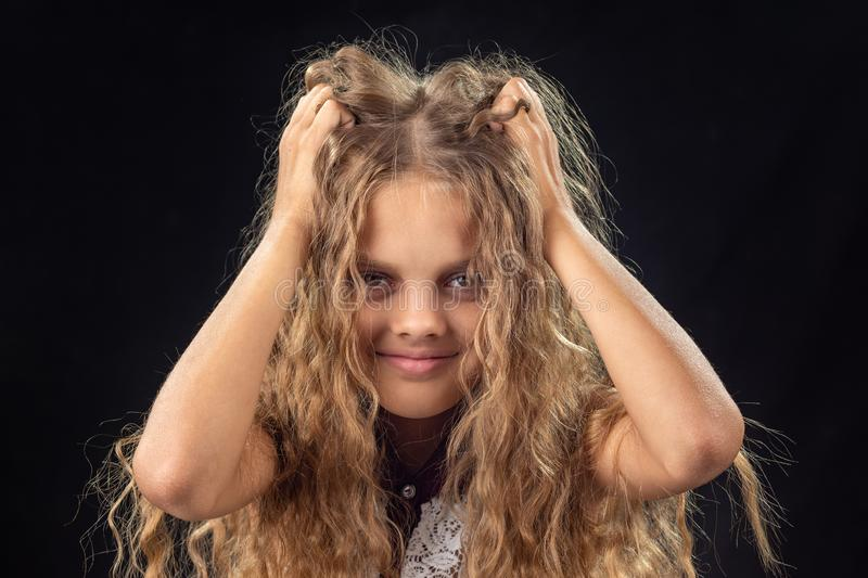 Ten-year-old girl shakes hands with long blond hair royalty free stock photography