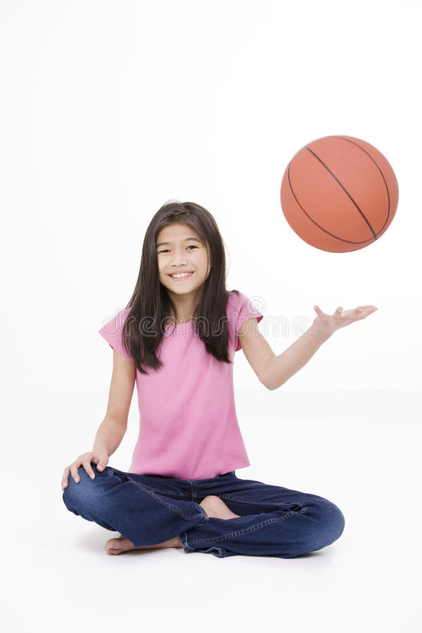 Download Ten Year Old Girl Throwing Basketball Stock Image - Image: 23749275
