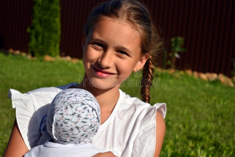 Ten-year-old Russian girl holds a favourite doll stock images