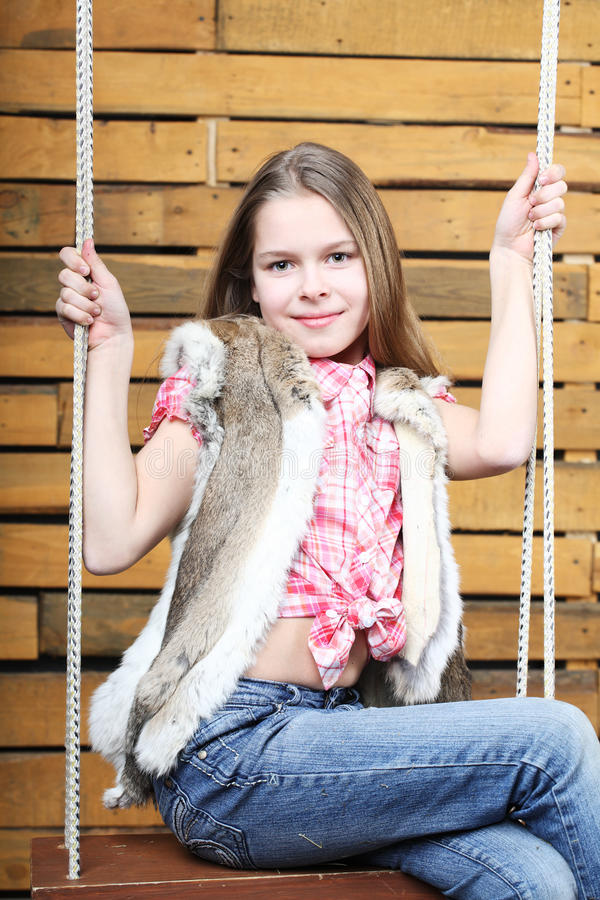 Ten years' girl. Shakes on a swing stock photo