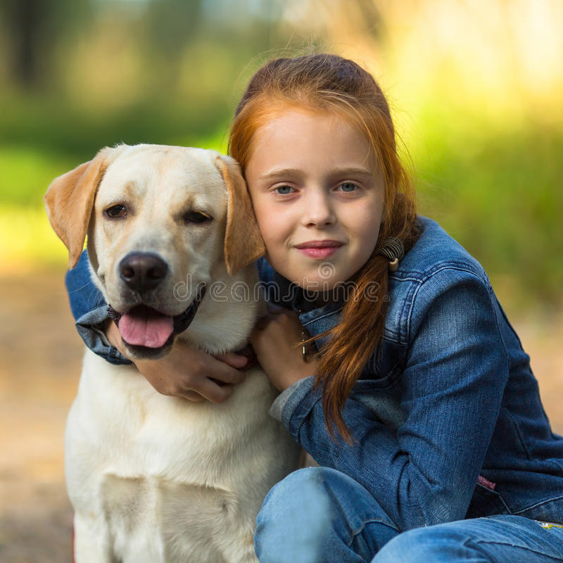 Ten years girl with her dog. Love. Ten years girl with her dog royalty free stock photo