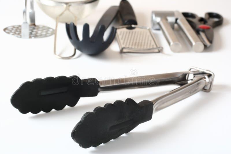 Tenaglie dell'utensile della cucina immagini stock libere da diritti